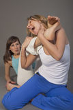 Two aggressive women fighting Royalty Free Stock Image