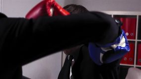 Two agressive competitors in gloves boxing and fighting in office room stock footage