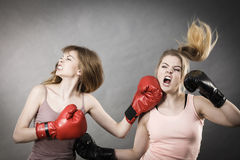 Two agressive women having boxing fight Stock Photos