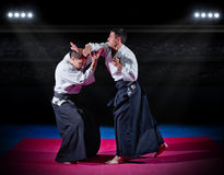 Two aikido fighters Royalty Free Stock Photos