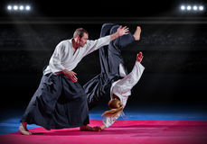 Two aikido fighters Stock Image