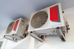 Two air conditioner. Hangs on a white wall royalty free stock photography