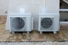 Two air conditioning units. Outside a house stock photo