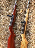 Two air guns put on straw in cowboy festival, Thailand Royalty Free Stock Photo