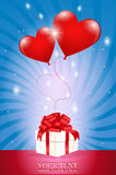 Two air red ball-heart attached to a gift box Stock Image
