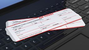 Two air tickets on black laptop Royalty Free Stock Images