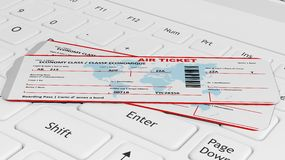 Two air tickets on white laptop Stock Images