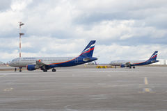 Two Airbus A320 aircraft of Aeroflot before the flight on the airfield of Sheremetyevo airport Stock Images