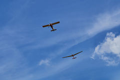 Two aircraft flying in the blue sky. royalty free stock photo