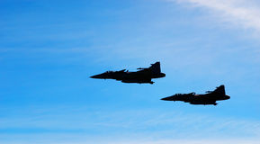 Two aircraft Jas 39 Gripen on blue sky Royalty Free Stock Photography