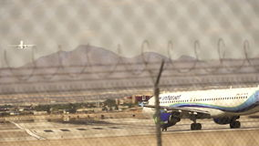 Two aircrafts on runway ready for take off  - LAS VEGAS. Nevada stock video footage