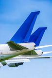 Two airliner tailplanes side by side Stock Photo