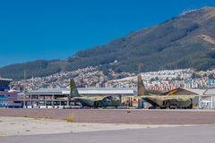 Two airplanes abandoned, this space used to be an airport. Behind a nice view of the city and a mountain Royalty Free Stock Photography