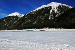 Two airplanes in different directions in St Moritz town Switzerland in the alps Stock Photos