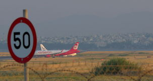 Two airplanes on runway at the airport. THESSALONIKI, GREECE - AUGUST 15, 2015: Airberlin and Ellinair airplanes moving on take-off strip at the airport. German stock video footage