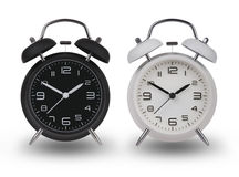 Two alarm clocks with the hands at 10 and 2 Royalty Free Stock Images