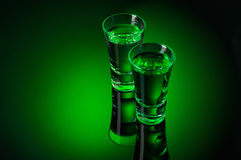 Two Alcohol Absinthe shots on black Stock Photos
