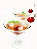 Two alcohol liqueur cocktails with cherry Royalty Free Stock Photo