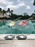 Two alcoholic cocktails at tropical villa near swimming pool stock photos