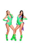 Two alluring smiley go-go dancers. Over white background Stock Photo
