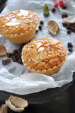 Two Almonds Sweet Tart on Crumpled Paper Royalty Free Stock Image