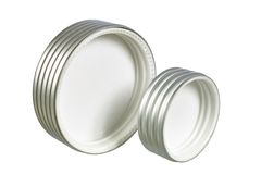 Two aluminium threaded caps for jars. Two aluminium threaded caps isolated on white background Stock Photography