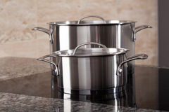Two aluminum pots on induction hob Stock Images