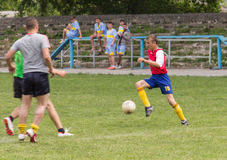 Two amateur football teams play on the field in Stock Images
