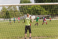 Two amateur football teams play on the field in Royalty Free Stock Photography