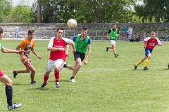Two amateur football teams play on the field in Stock Photo