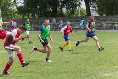 Two amateur football teams play on the field in Royalty Free Stock Photo