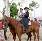 Two amazons wearing traditional Andalusian uniforms at the April's Fair of Seville Stock Photo
