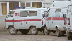 Two ambulances are at home slow motion video. Two ambulances in Russia are at the house slow motion video stock footage