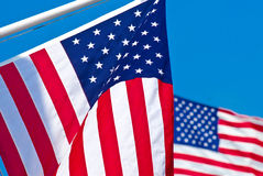 Two American flags. Two American Flags wave in the breeze Stock Photo