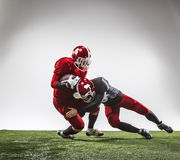 The two american football players in action Stock Images