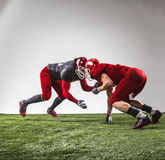 The two american football players in action Stock Photos