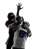 Two american football players pass action silhouette. Two american football players pass action in silhouette shadow on white background Royalty Free Stock Photos