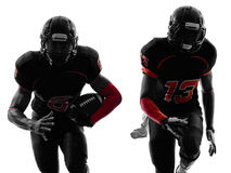 Two american football players running silhouette royalty free stock image