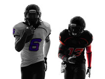 Two american football players running silhouette. Two american football players running in silhouette shadow on white background Royalty Free Stock Photography