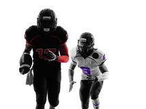 Two american football players running silhouette Stock Image