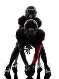 Two american football players on scrimmage silhouette. Two american football players on scrimmage in silhouette shadow white background Royalty Free Stock Photography