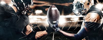 Two american football sportsman players on stadium. Sport concept. American Football player on stadium with smoke and lights royalty free stock image