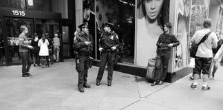 Two american policewomen patrolling city street in new york, usa. New York, USA - November 13, 2008: two american policewomen or pretty women, police officers Royalty Free Stock Photos
