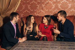Two amorous couples celebrating together at restaurant stock images