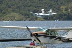 Two Amphibious seaplane landing on Lake Casitas, Ojai, California Royalty Free Stock Photos