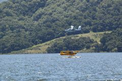 Two Amphibious seaplanes landing on Lake Casitas, Ojai, California Royalty Free Stock Photos