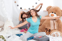 Two amusing cheerful sisters having fun Royalty Free Stock Photo