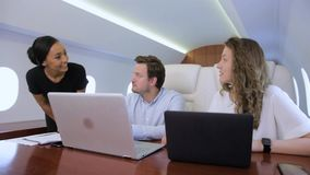 Two businessmen work on private plane