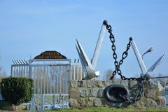 Two anchor at the entrance of a pleasure boat harbor Royalty Free Stock Photos