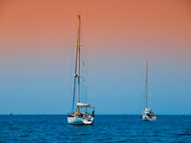 Two anchoring yachts Stock Images
